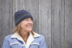 Joyful woman in warm bonnet and jacket outdoor Royalty Free Stock Photo