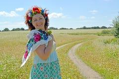 The joyful woman with a wreath on the head against the backgroun Stock Photography