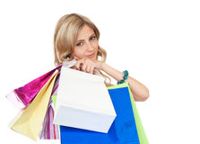 Joyful women customers with their purchases. Royalty Free Stock Image