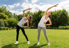 Joyful women doing sport exercises Royalty Free Stock Images