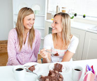 Joyful women eating a chocolate cake Royalty Free Stock Image