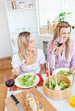 Joyful women having fun while eating salad Royalty Free Stock Photos