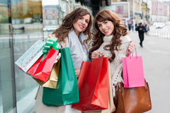 Joyful women with shopping bags Royalty Free Stock Photography