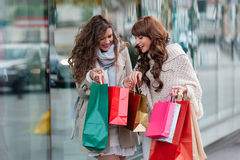 Joyful women with shopping bags Stock Photos