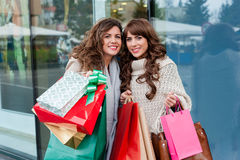 Joyful women with shopping bags Stock Images