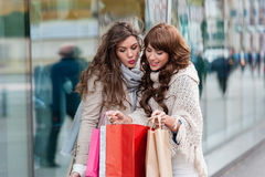 Joyful women with shopping bags Stock Photography