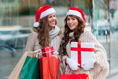 Joyful women with shopping bags Royalty Free Stock Photos