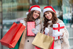 Joyful women with shopping bags Royalty Free Stock Images
