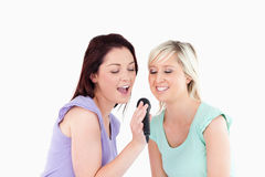 Joyful Women singing karaoke Stock Image