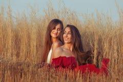 Joyful women in the field. Royalty Free Stock Image