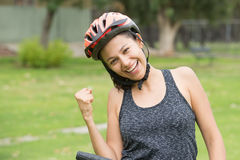 Joyful young active bicycle woman outdoor portrait. Portrait active sporty attractive young cheerful hispanic woman on bicycle, wearing helmet, happy relaxed Royalty Free Stock Photography