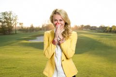 Joyful young blond woman outdoor. Royalty Free Stock Images