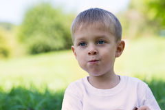 Joyful young boy with his mouth full of chocolate Royalty Free Stock Photo