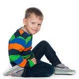 Joyful young boy. A portrait of a joyful young boy on the white background Royalty Free Stock Photos