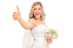 Joyful young bride giving a thumb up Stock Images