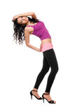 Joyful young brunette in a black leggings Stock Photos