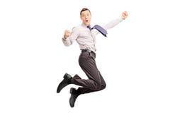 Joyful young businessman gesturing happiness Stock Photos