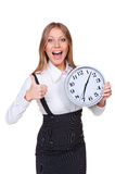 Joyful young businesswoman holding clock Stock Images