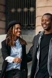 Joyful young couple. Happy African American. With smile. Stylish black people on street, youth love relationships, happiness concept Stock Photography