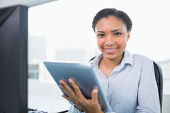 Joyful young dark haired businesswoman using a tablet pc Royalty Free Stock Photo