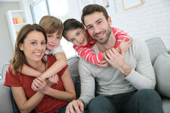 Joyful young family spending time together Stock Photography
