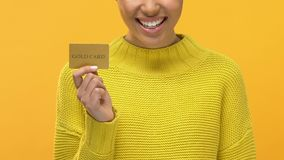 Joyful young female holding gold credit card hands, shopping sale, consumerism. Stock footage stock video