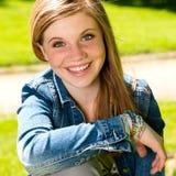 Joyful young girl enjoying sunshine outdoors Stock Image
