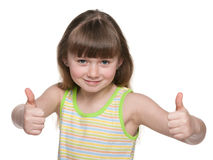 Joyful young girl holds her thumbs up Royalty Free Stock Photography