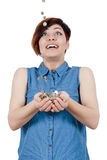 Joyful young girl put your hands under the rain of coins Royalty Free Stock Photos