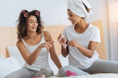 Joyful young ladies preparing for party together Stock Photography