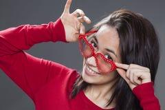 Joyful young lady playing around with sunglasses Stock Image