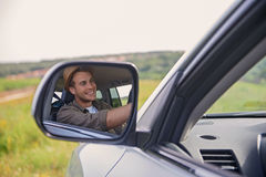 Joyful young man driving transport Royalty Free Stock Image