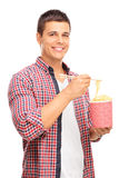 Joyful young man eating Chinese noodles Royalty Free Stock Photography
