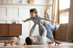 Free Joyful Young Man Father Lifting Excited Happy Little Son. Royalty Free Stock Image - 172732916
