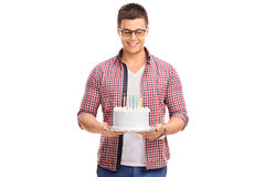 Joyful young man holding a birthday cake Stock Photography