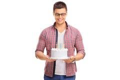 Joyful young man holding a birthday cake Stock Photography