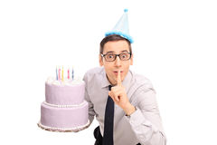 Joyful young man holding a birthday cake Stock Photo