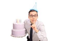 Joyful young man holding a birthday cake Stock Photo