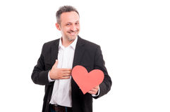 Joyful young man holding paper heart Royalty Free Stock Photography