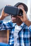 Joyful young man using virtual technologies Stock Images