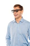 Joyful young man wearing goggles looking away Stock Images