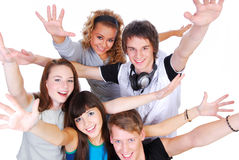 Joyful young people. Group of joyful young people with the hands stretched upwards on a white background Royalty Free Stock Photos