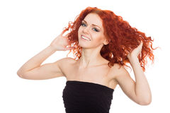 Joyful young woman with arms raised Stock Photo