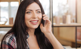 Joyful young woman being in a wonderful mood Stock Image