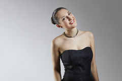 Joyful young woman in black corset Royalty Free Stock Images