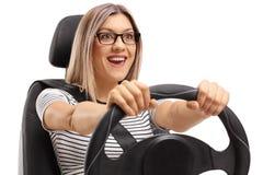 Joyful young woman driving Stock Photos