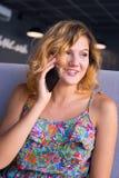 Joyful young woman enjoying life in a cafe Royalty Free Stock Photography