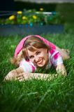 Joyful young woman on grass Royalty Free Stock Photography