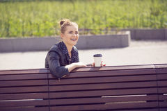 Joyful young woman having coffee break Royalty Free Stock Image