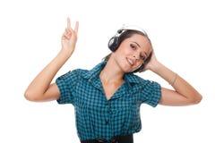 Joyful young woman in headphones Stock Image